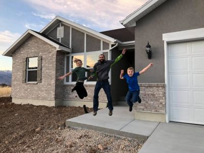 Happy family after buying a home with the help of Gina Luke.