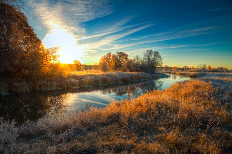 River bathed in sunrise in the Wasatch Mountains.